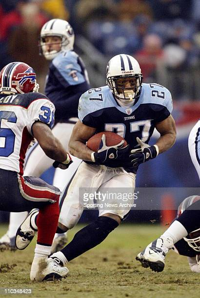 Eddie George of the Tennessee Titans during the Titans 2826 victory over the Buffalo Bills at the Coliseum in Nashville TN