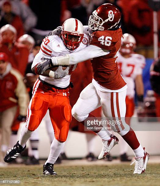 Oklahoma Sooners player Zach Latimer tackles Nebraska Cornhuskers player Marlon Lucky in the second half during the Big 12 Conference Championship...