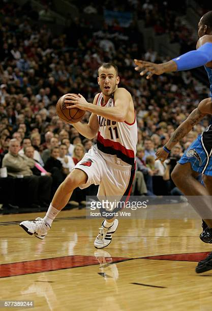 Portland Trail Blazers guard Sergio Rodriguez drives to the basket against Orlando Magic center Dwight Howard during their NBA basketball game at the...