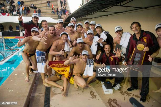 Head coach Jovan Vavic right of USC poses with his team and the championship trophy after a victory against University of the Pacific during the...