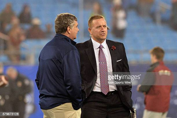 06 Dec 2014 ABC commentator Kirk Herbstreit talks with Georgia Tech Head Coach Paul Johnson before the ACC Championship Game between Florida State...
