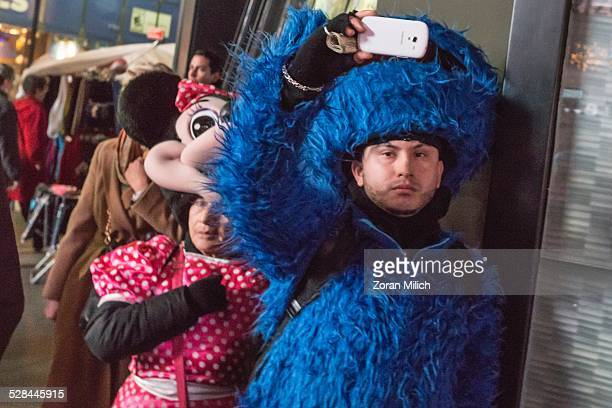 3 Dec 2014 New York USA Protesters for Eric Gardener and Michael Brown are photographed by costumed people during a hands up protest walk into Times...