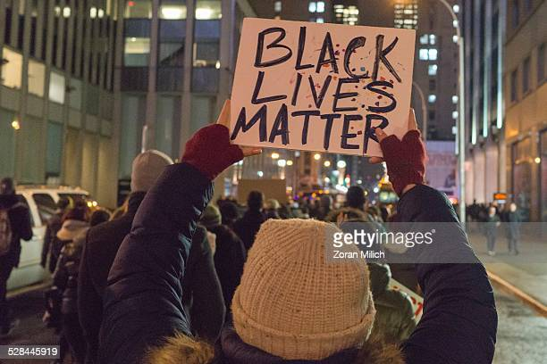 3 Dec 2014 New York USA Protesters for Eric Gardener and Michael Brown Brown during a hands up protest walk into Times Square A Grand jury would not...