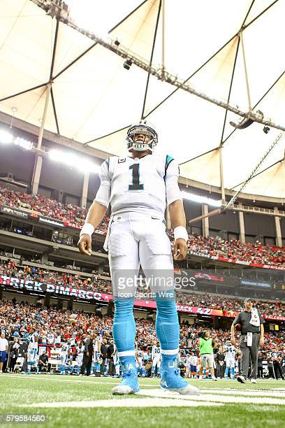 Carolina Panthers quarterback Cam Newton looks on as the Atlanta Falcons take the field before 4the NFL game between the Carolina Panthers and the...