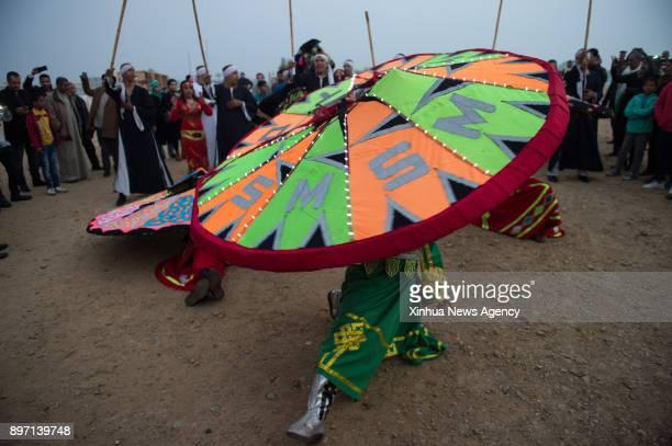 FAYOUM Dec 21 2017 Local dancers perform Sufi Dancing to celebrate the annual Sun Festival in the Temple of Qasr Qaroun in Fayoum Governorate some 90...