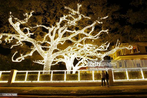 Dec. 22, 2020 -- People look at a Christmas decoration in New Orleans, Louisiana, the United States, on Dec. 22, 2020.