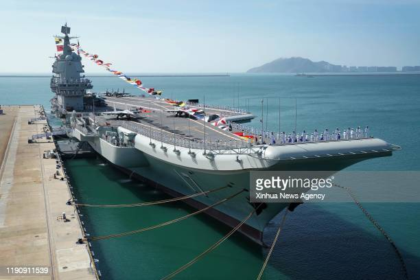 SANYA Dec 27 2019 Photo taken on Dec 17 2019 shows the Shandong aircraft carrier at a naval port in Sanya south China's Hainan Province China's first...