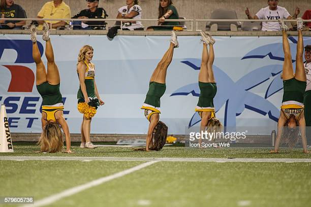 Baylor Bears cheerleaders perform handstands during the Russell Athletic Bowl game between the North Carolina Tar Heels and the Baylor Bears at the...