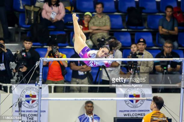 MANILA Dec 3 2019 Farah Ann Abdul Hadi of Malaysia competes during the final match of the women's gymnastic artistic uneven bars at the Southeast...