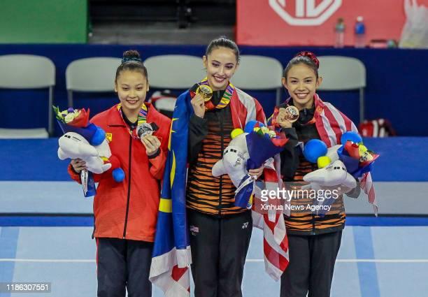 MANILA Dec 3 2019 Gold medal winner Farah Ann Abdul Hadi C of Malaysia poses with silver medalist Do Thi Ngoc Phuong L of Vietnam and bronze medalist...