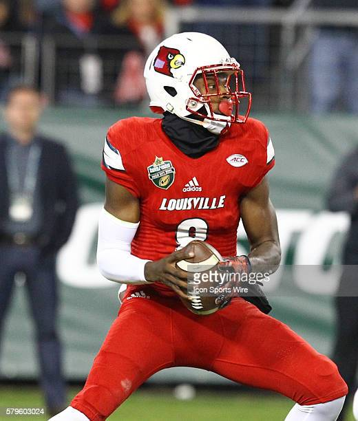 Louisville Cardinals quarterback Lamar Jackson looks to pass the ball during the first half of the Franklin American Mortgage Music City Bowl matchup...