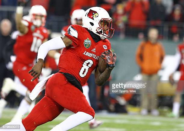 Louisville Cardinals quarterback Lamar Jackson runs for a first down during the first half of the Franklin American Mortgage Music City Bowl matchup...