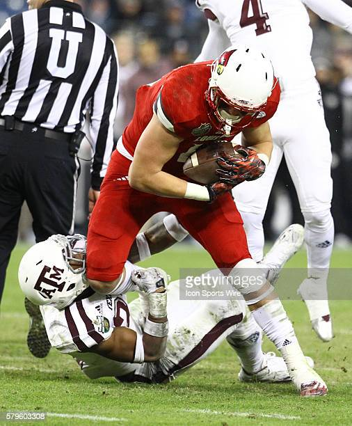 Louisville Cardinals tight end Cole Hikutini in second half action the Franklin American Mortgage Music City Bowl matchup between Texas AM and...