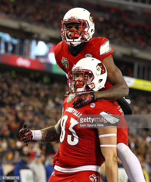 Louisville Cardinals tight end Micky Crum scores a touchdown and celebrates with Louisville Cardinals quarterback Lamar Jackson during the third...
