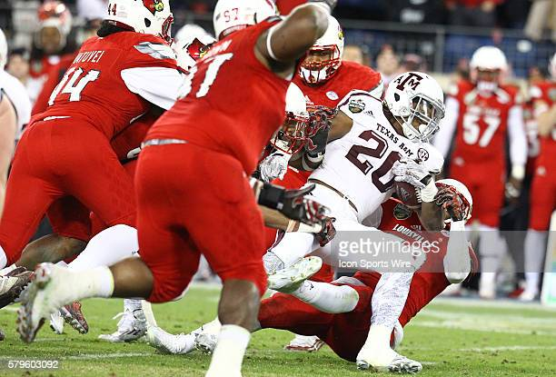 Texas A&M Aggies running back James White runs for a first down during the first half of the Franklin American Mortgage Music City Bowl match-up...