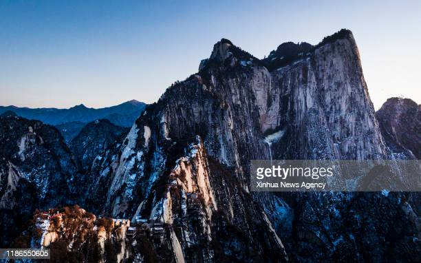 XI'AN Dec 5 2019 Aerial photo taken on Dec 4 2019 shows a view of Mount Huashan during sunset in northwest China's Shaanxi Province
