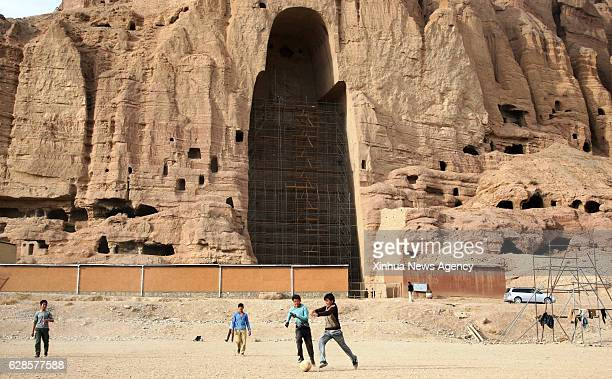 BAMYAN Dec 6 2016 Afghan children play football in front of the ruined Buddha in Bamyan province Afghanistan Dec 6 2016 Both the 53meter and 35meter...