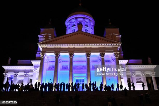 A cathedral building is illuminated with blue and white lights rebembling the national flag colors in Helsinki Dec 6 2017 The year of 2017 marks the...