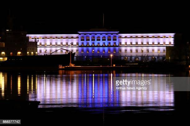 The office building of the Foreign Ministry is illuminated with blue and white lights rebembling the national flag colors in Helsinki Dec 6 2017 The...