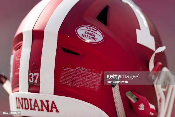 A decal commenting the life of the late Coach Bill Mallory is seen on the helmet of Indiana Hoosiers running back Ahrod Lloyd in a game between the...