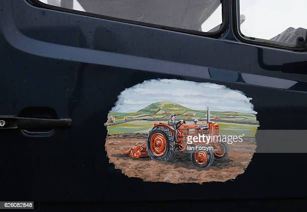 Decal of a tractor ploughing a field is seen on the door of a lorry during the annual ploughing match on November 27, 2016 in Staithes, United...