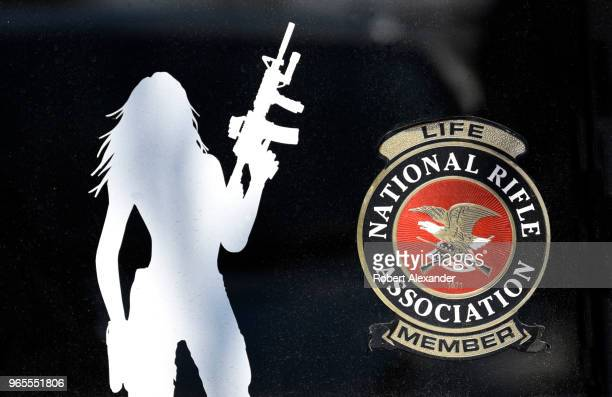 Decals on a female gun owner's rear car window indicates she is a life member of the National Rifle Association