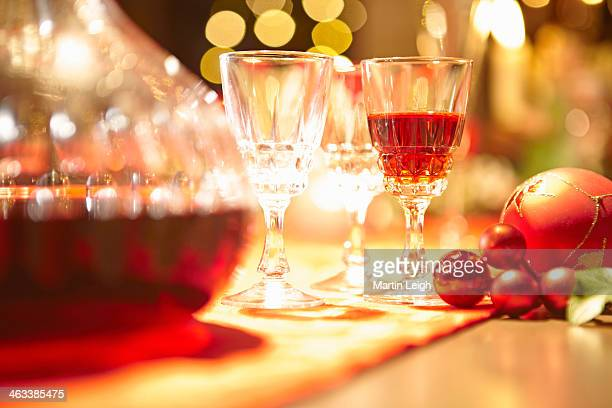 decanter and sherry glasses with xmas baubles