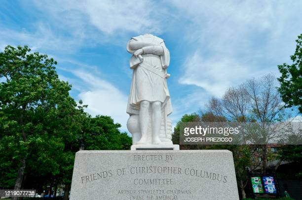 A decapitated statue of Christopher Columbus is viewed at Christopher Columbus Park in Boston Massachusetts on June 10 2020 The statue's head damaged...