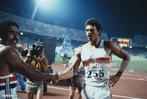 Decathletes Daley Thompson of Great Britain and Jurgen Hingsen of West Germany shake hands at the European Championships in Athletics at the Olympic...