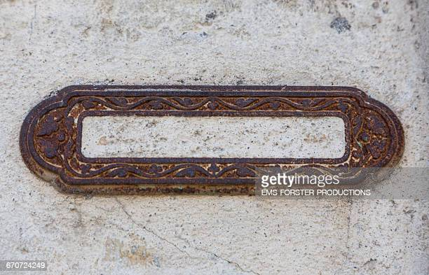 decayed mailbox frame on a old house wall