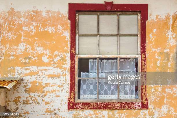 Decayed Window in Colorful Wall