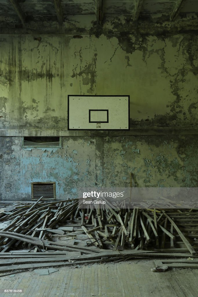 A decaying basketball court stands in the ghost town of