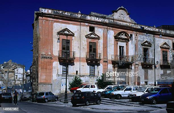 Decaying facade of derelict houses bombed in WWII in one of the original quarters of Palermo, Il Ballaro.