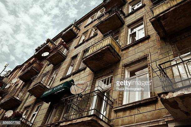 Decaying facade of housing building in the Praga district of Warsaw, Poland
