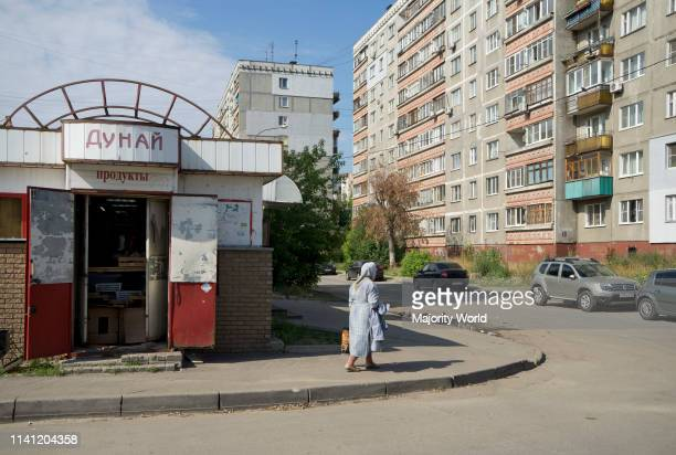 Decaying social housing and shops in a modest neighbourhood of the industrial city of Nizhny Novgorod on the Volga river Russia