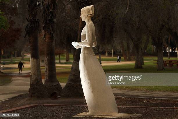 LOS ANGELES CA THURSDAY FEBRUARY 6 2014 A decaying statue of Florence Nightingale that overlooks a lake in Lincoln Park Recently someone took it upon...