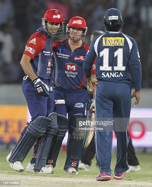 Deccan Chargers captain Kumar Sangakara congrutulating the Delhi Daredevil players David Warner and Naman Ojha on their victory in IPL T20 match...