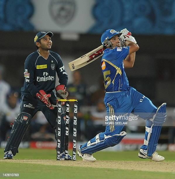 Deccan Chargers wicket keeper Parthiv Patel watches as Mumbai Indians Rohit Sharma plays a shot during the IPL Twenty20 match between Deccan Chargers...