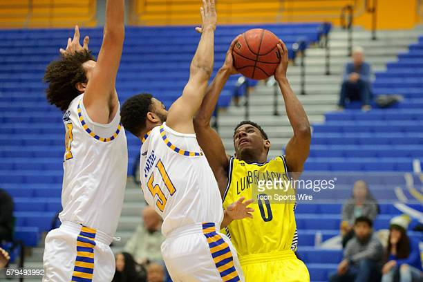 Northern Arizona Lumberjacks guard Torry Johnson drives to the basket with Cal State Bakersfield Roadrunners guard Justin Pride defending during the...