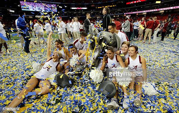 The Alabama Crimson Tide cheerleaders and mascot frolic in the confetti after Alabama wins the SEC Championship game at the Georgia Dome in Atlanta GA