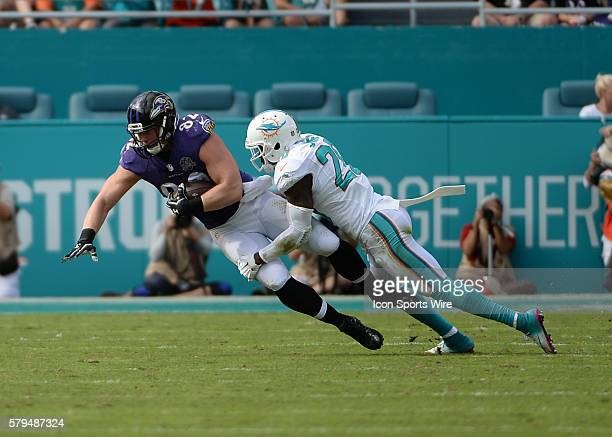 December 06 2015 Baltimore Ravens tight end Nick Boyle holding the football as Miami Dolphins cornerback Bobby McCain tries to tackle him during the...