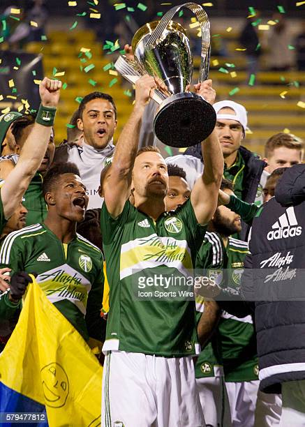 Portland Timbers defender/midfielder Jack Jewsbury lifts the MLS Cup Trophy after the MLS Cup held at MAPFRE Stadium in Columbus Ohio