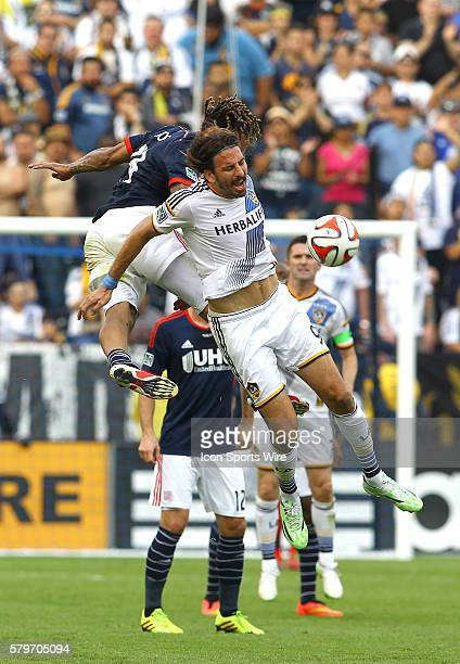 New England Revolution midfielder Jermaine Jones clashes with Los Angeles Galaxy forward Alan Gordon during the 2014 MLS Cup at StubHub Center in...
