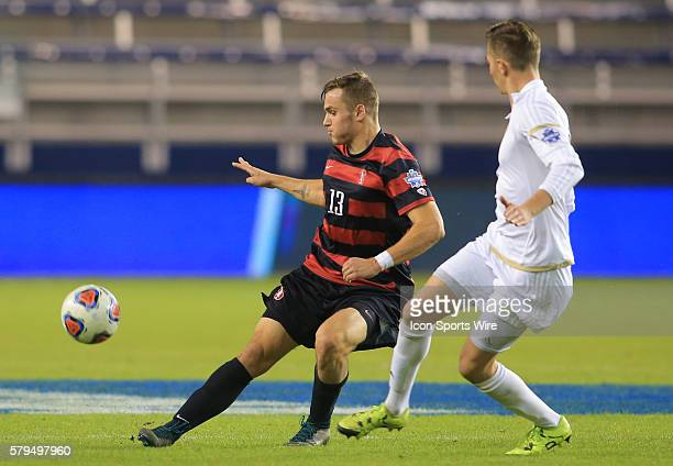 Stanford Jordan Morris fires a pass away from Akron Danilo Radjen during a semifinal match of the 2015 men's College Cup at Children's Mercy Park, in...