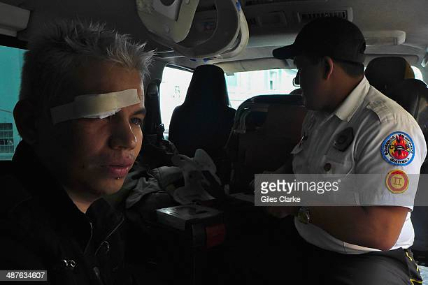 December 11 2013 in Guatemala City Guatemala A mugging victim sits in an ambulance after his mobile phone was stolen The bomberos voluntarios are a...