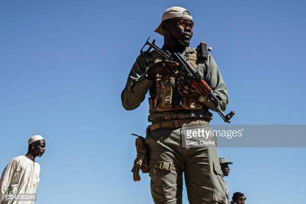 December 11, 2019. A Niger security guard at a refugee center in Diffa, eastern Niger. Militant groups attack civilians and security forces in and...