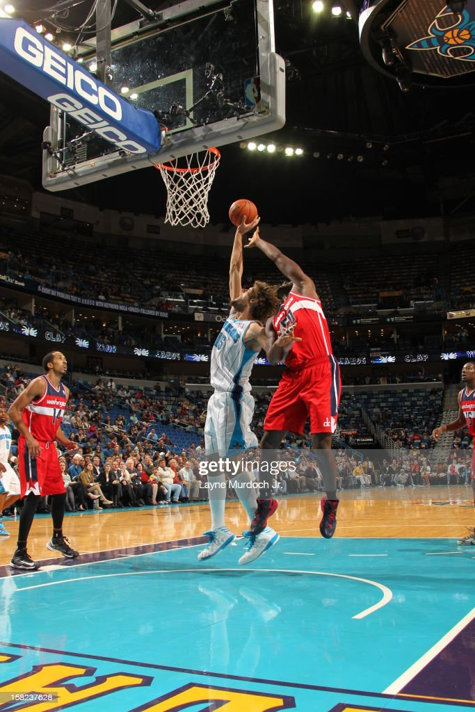 Robin Lopez #15 of the New Orleans Hornets trys to grab the ball in the air against the Washington Wizards on December 11, 2012 at the New Orleans Arena in New Orleans, Louisiana.