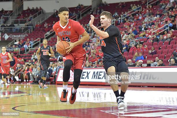 Fresno State Bulldogs forward Cullen Russo goes into the paint as University of Pacific Tigers guard Aaron Hendricks defends during the Fresno State...