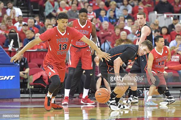Fresno State Bulldogs forward Cullen Russo steals the ball from University of Pacific Tigers guard Aaron Hendricks during the Fresno State Bulldogs...