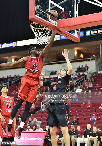 Fresno State Bulldogs forward Karachi Edo blocks the shot by University of Pacific Tigers guard Aaron Hendricks during the Fresno State Bulldogs vs...